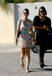 Katy's white, pointed toe flats have a heart embellished toe that take them from drab to fab. So cute!