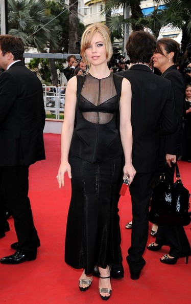 Melissa George completed her look with strappy metallic heels.