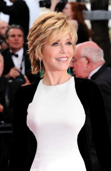 Jane Fonda stepped onto the red carpet at the 'Rust and Bone' premiere wearing exquisite 18-carat white gold earrings set with large emeralds and white diamonds.