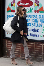 SJP takes a stroll in her NYC neighborhood after dropping her son James off at school. She carried a large shoulder satchel, which is sure to fit all of her essentials for the day.