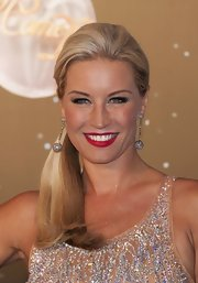 Denise van Outen matched her sparkling dress with a pair of dangling glitter earrings.