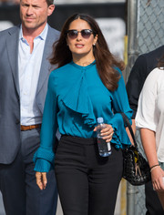 Salma Hayek accessorized with a pair of retro wayfarers as she headed to 'Jimmy Kimmel Live.'