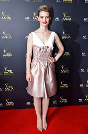 Mia Wasikowska wore a crisp petal pink cocktail dress with bold red lips for the AACTA Awards.