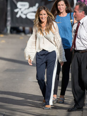 Sarah Jessica Parker chose a pair of sporty side-striped pants to team with her blouse.