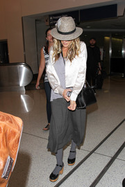 Sarah Jessica Parker teamed her jacket with a simple gray midi skirt.