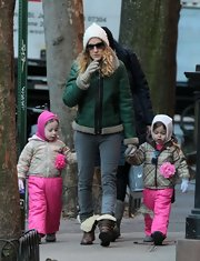 Sarah Jessica Parker fought the NY chill in this emerald zip-up jacket.