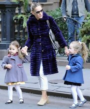 SJP looked high-fashion in this lush purple coat while out with her two darling daughters.