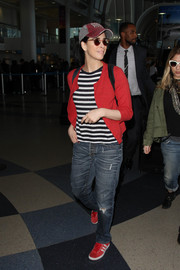 Sarah Silverman matched her cardigan with red suede sneakers by Adidas.