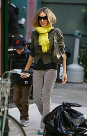 Sarah was spotted strolling the streets of NYC with her son James wearing a bight sunny scarf.