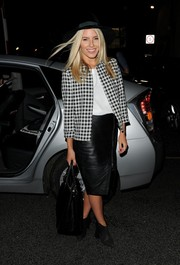 Mollie King styled her outfit with a pair of tasseled black booties.
