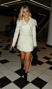 Mollie King opted for a white wool coat with over-sized lapels and a belt for her cool and chic look at the ITV Studios.