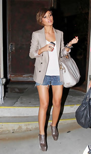 Frankie Sandford teamed her denim cut off shorts with taupe python-sude platform ankle booties.