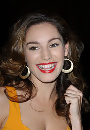 Kelly Brook paired her classic red lipstick with gold hoop earrings while attending the Scarlet Series launch party.