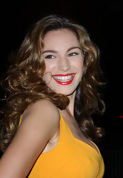 Kelly Brook styled her long brunette tresses in soft curls at the Scarlet Series launch party.