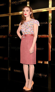 Scarlett's sherbert colored peep-toe pumps complement her floral top and add a bright, fun feel to this look.