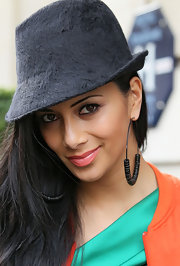 Nicole Scherzinger completed her stylish look with large black hoop earrings with delicate beading.