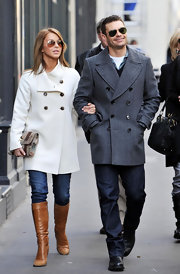 Ryan dons a sophisticated gray herringbone pea coat while out in Paris with girlfriend, Julianne Hough.