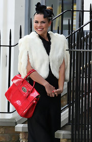 Billie Piper showed off her patent leather red tote bag while filming 'Secret Diary of a Call Girl'.