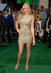 Amanda showed off her sparkling gold dress while hitting the 'Secretariat' premiere.