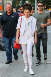 Selena Gomez sealed off her all-white outfit with a pair of Louis Vuitton leather sneakers.