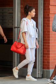 Selena Gomez showed off a stylish red shoulder bag by Coach while out and about in New York City.