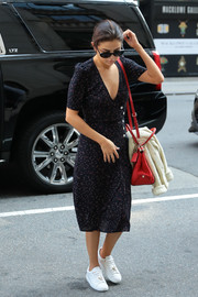 Selena Gomez was seen out in New York City wearing a micro-print midi dress by Rouje teamed with Louis Vuitton sneakers.
