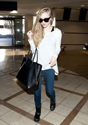 Amanda Seyfried looked casual with an edge in this blousy scoopneck sweater for her travels at LAX.