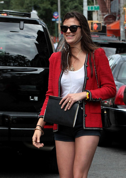 Shermine Shahrivar pulled off a chic outfit featuring a red tweed blazer, a white tank top, and some short shorts to flaunt her legs.