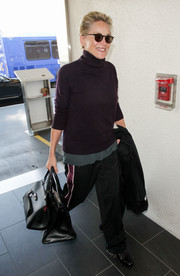 Sharon Stone had her hand full with two leather totes.