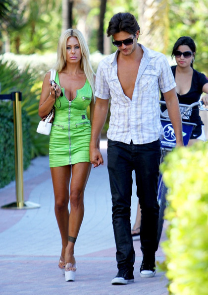 Shauna Sand was a bright sight on the streets of Miami in a zippered neon-green mini dress.