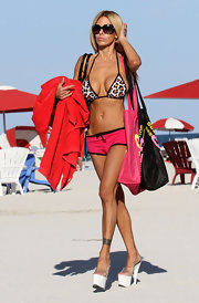 Shauna Sand spent a day at the beach wearing tiny pink shorts with a leopard-print bikini.
