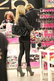 Shauna Sand was spotted shopping in Beverly Hills carrying a black patent leather Chanel bag.