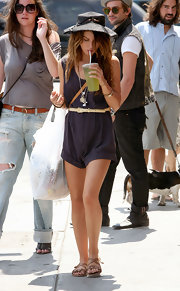 Shenae is a repeat offender! She belts her jumpsuit. Her hippie chic style is a trend across 90210 fans.