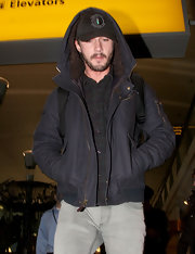 Shia LaBeouf cozied up in a hooded zip-up jacket for a flight.