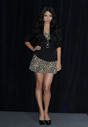 Vanessa Hudgens balanced her flirty leopard print dress with a black belted blazer.