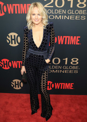 Malin Akerman worked her figure in a midnight-blue Zhivago jumpsuit with a plunging neckline and see-through panels at the Showtime Golden Globe nominees celebration.