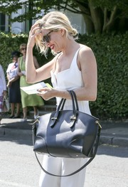 Sienna Miller was spotted at Wimbledon carrying a chic black Alexander McQueen leather tote.