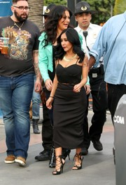 Nicole Polizzi injected an extra dose of allure with a pair of black gladiator heels.