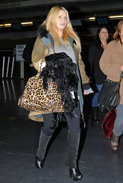 Jessica Simpson carried an on trend leopard print Prada bowler while making her way through JFK Airport.