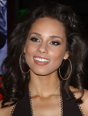 Alicia wore large gold hoops with her elegant ensemble at the 'Smokin' Aces' premiere.