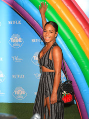 Christina Milian arrived for the sneak peek of 'True and the Rainbow Kingdom' carrying a fringed, chain-strap bag.