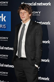 Jesse kept things simple and classic in a charcoal grey suit and matching tie.