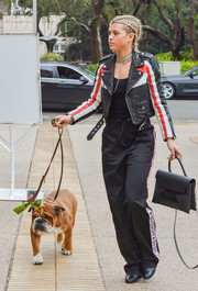 Sofia Richie made a cool statement with this black, white, and red leather jacket by Maje while out and about.