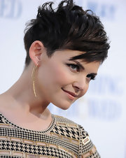 Ginnifer Goodwin accented her edgy cut with Oscar Niemeyer earrings in 18-karat yellow gold at the premiere of 'Something Borrowed.'