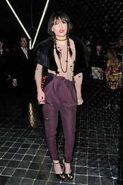 Daisy Lowe added a playful touch to her look with black ankle strap peep toes adorned with black and yellow bows.