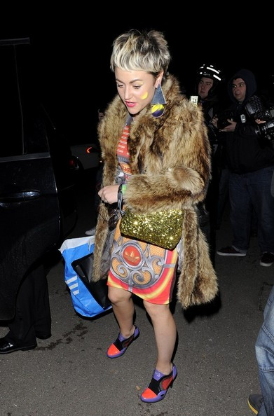 Jamie Winstone's fur coat added a touch of glam to her funky Brit Awards dress.