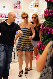 Britney did a little shopping in Australia in a ruffled stripped dress and black patent sandals.