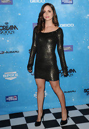 """Eliza's looking very sultry in her black patent leather """"Bianca"""" pumps paired with a sequined mini dress."""