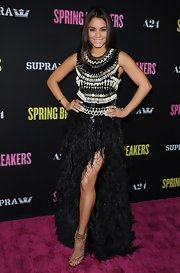 Vanessa Hudgens showed off some leg in this exotic evening gown with tribal beading on the bodice and a feathered skirt.