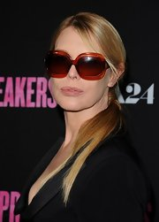 Deborah Kara Unger opted for a low ponytail for her casual but classy red carpet look at the 'Spring Breakers' premiere.